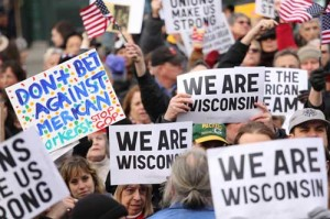 """a crowd of people at the demonstration, who hold signs that says """"we are wisconsin"""""""