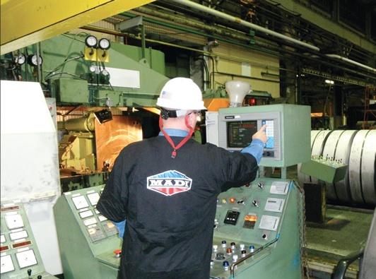 Madi worker, while working on the machine