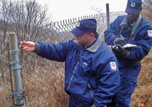 strike security officers checking perimeter fence of property